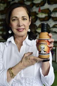 "<p>Bottles of Papou's Comeback Sauce are sold at Central Market. The label of the bottle includes a photo of Callie McDole's father, Mike <span style=""font-size: 1em; background-color: transparent;"">Kountouris.</span></p>(Ben Torres/Special Contributor)"