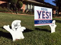 Halloween decorations adorn a Vote Yes sign in the front yard of a North Arlington home. The Vote Yes! camp is trying to get voters to approve a new $1 billion ballpark with half of the funding coming from Arlington taxpayers.(Tom Fox/Staff Photographer)