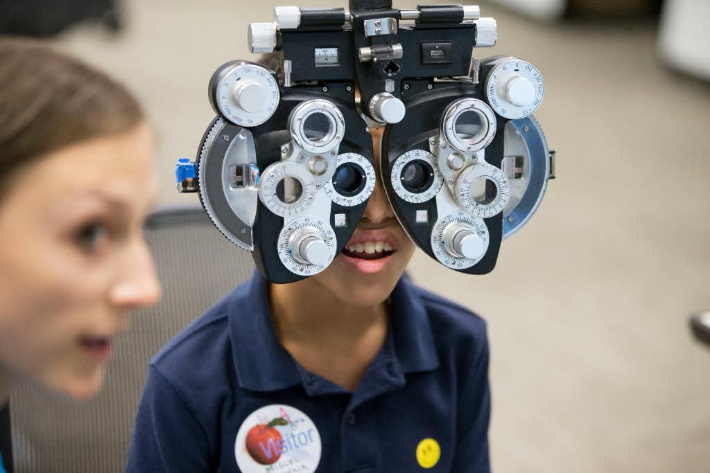 Miguel Bahena, 10, of Carrollton, Texas, gets a free eye exam provided by Essilor Vision Foundation during World Sight Day at Essilor of America on Oct. 13, 2016 in Dallas, Texas. (Ting Shen/The Dallas Morning News)Staff Photographer