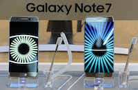 In this Tuesday, Oct. 11, 2016 photo, Samsung Electronics Galaxy Note 7 smartphones are displayed at its shop in Seoul, South Korea.  (AP Photo/Lee Jin-man)