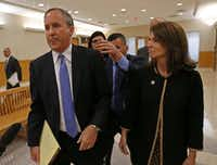 Texas Attorney General Ken Paxton, left, and his wife Angela leave a courtroom after his pre-trial motion hearing at the Collin County courthouse on Tuesday, Dec. 1, 2015, in McKinney, Texas.(Jae S. Lee/Staff Photographer)
