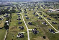 "Aerial view of homes in Lucas, Texas on Thursday, August 11, 2016. (<p><span style=""font-size: 1em; background-color: transparent;"">Vernon Bryant/The Dallas Morning News</span></p>)"
