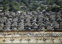 "Established neighborhood, new homes and homes under construction in McKinney on Thursday, August 11, 2016. <p><span style=""font-size: 1em; background-color: transparent;"">Vernon Bryant/The Dallas Morning News</span></p>"