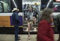 "Dart riders exit the train at Cityplace/Uptown Station in their underwear during the No Pants Subway Ride Dallas event on Sunday, Jan. 10, 2016. (<p><span style=""font-size: 1em; background-color: transparent;"">Rex C. Curry/Special Contributor</span></p>)"