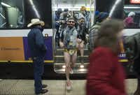 "Dart riders exit the train at Cityplace/Uptown Station in their underwear during the No Pants Subway Ride Dallas event on Sunday, Jan. 10, 2016. <p><span style=""font-size: 1em; background-color: transparent;"">Rex C. Curry/Special Contributor</span></p>"
