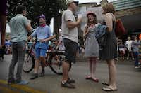 "Max Rasor, left, Colin Clarke, second from left, Timmy Martin, center, Andee Pittman and Christa Martin, right, chat during Bastille on Bishop on July 14, 2013 on Bishop Ave. in Dallas. The festival featured outdoor markets, wine tastings, music, dancing and games to celebrate French culture and the arts in Dallas. (<p><span style=""font-size: 1em; background-color: transparent;"">Sarah Hoffman/The Dallas Morning News</span></p>)"