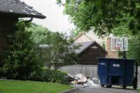 The remains of a fire at the home of Ira Tobolowsky, a longtime civil lawyer, along Kenshire Lane in Dallas, as seen on May 19. Tobolowsky was found dead in his garage the week before. (File Photo/Andy Jacobsohn)
