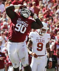 Oklahoma Sooners defensive lineman Neville Gallimore (90) reacts after a tackle is made in the second half during the Red River Showdown between the Oklahoma Sooners and Texas Longhorns at the Cotton Bowl at Fair Park in Dallas Saturday October 8, 2016. Oklahoma Sooners beat Texas Longhorns 45-40. (Andy Jacobsohn/The Dallas Morning News)(Staff Photographer)