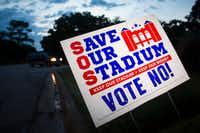 Yard signs expressing opposition to a proposal $1 billion retractable-roof stadium for the Texas Rangers are seen in a residential neighborhood. Voters will decide Nov. 8 whether to contribute $500 million worth of public money to the project. (Smiley N. Pool/The Dallas Morning News)