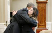President Barack Obama gives a hug to Dallas nurse Nina Pham in the Oval Office of the White House October 24, 2014 in Washington, DC. Pham, a nurse who was infected with Ebola from treating patient Thomas Eric Duncan at Texas Health Presbyterian Hospital in Dallas and was first diagnosed on October 12, was declared free of the virus on Friday. (Photo by Olivier Douliery-Pool/Getty Images)