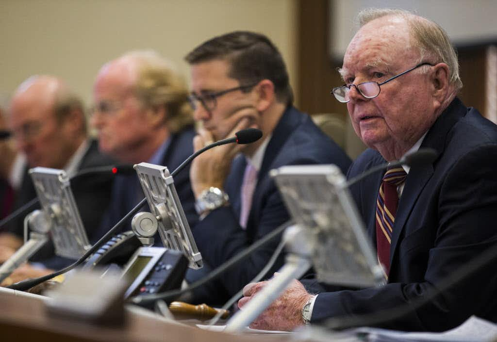Mayor Olin Lane (right) spoke as he and the University Park City Council considered a proposed plan for what to do with a vacant Chase Bank building on Tuesday at City Hall. They voted to allow developer James Strode to move ahead with plans for a mixed-use development, with some modifications.Ashley Landis/Staff Photographer
