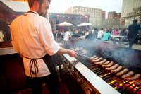 A cook grilling sausages on FoodLab's terrace.(Tourism Montreal)