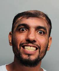 This Monday, Oct. 17, 2016, photo provided by the Miami-Dade Corrections and Rehabilitation Department shows Carlos Rodriguez, who is facing arson and attempted first-degree murder charges. (Miami-Dade Corrections and Rehabilitation Department via AP)(AP)