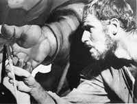 "Michelangelo, played by Charlton Heston, is shown at work in a scene from the movie ""The Agony and the Ecstasy"" based on the 1961 novel. (File Photo/The Associated Press)"
