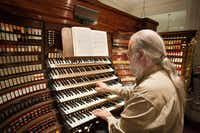 Michael Barone, host of Pipedreams, at the Wanamaker Organ in Philadelphia.(Scott Cantrell)