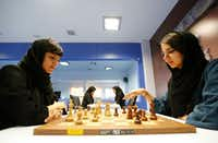 Iranian chess players Mitra Hejazipour (L) and Sara Khademalsharieh play at the Chess Federation in the capital Tehran on October 10, 2016. For the Iranian players the veil is not a sign of oppression, they oppose a campaign launched in the United States against the holding of the Women's World Championship in February in Tehran.(AFP/Getty Images)
