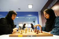 Iranian chess players Mitra Hejazipour (L) and Sara Khademalsharieh play at the Chess Federation in the capital Tehran on October 10, 2016. For the Iranian players the veil is not a sign of oppression, they oppose a campaign launched in the United States against the holding of the Women's World Championship in February in Tehran. (AFP/Getty Images)