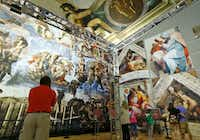 People look at the photo reproduction of the Sistine Chapel at Fair Park. (Nathan Hunsinger/The Dallas Morning News)