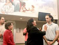 Landlord Khraish Khraish of HMK Ltd. had a tense altercation Saturday with West Dallas tenants and community leaders over plans for mass evictions. Mayor Pro Tem Monica Alonzo, who represents West Dallas, tried to calm those in attendance.(Diane Solis/Staff)