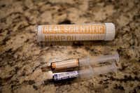 These are syringes of hemp oil that were used by Dustin and Penny Howard to ease their daughter Harper's seizures. (Ting Shen/Staff Photographer)