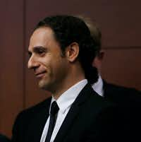 Khraish Khraish, co-owner of HMK Ltd., listened in the courtroom as the judge granted an extension on a temporary restraining order. Khraish has been in negotiations with the city of Dallas over a delay in evictions. (Rose Baca/The Dallas Morning News)