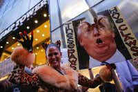 A woman dressed up as a feline takes part of a protest outside Trump Tower in New York to protest against Republican presidential candidate Donald Trump for his treatment of women. ((File Photo/Agence France-Presse)