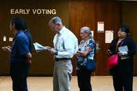 Voters stand in line Monday, Oct. 24, 2016, at the Nueces County Courthouse on the first day of early voting for the Nov. 8 election.   (Courtney Sacco/Corpus Christi Caller-Times via AP)