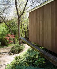 Steel beams support the bedroom wing, shown in 2008, which cantilevers out over the property's steep drop. (Stephen Karlisch/Special Contributor)