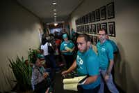 David Villalobos, an organizer for the Texas Organizing Project, waits with HMK tenants outside the Mayor's Office to schedule a meeting after attending a city council meeting in Dallas City Hall on Wednesday, Oct. 26, 2016.(Rose Baca/Staff Photographer)