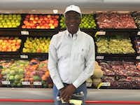 Joseph Kemp stands in front of produce at his new Save-A-Lot store at 3450 Simpson Stuart Road. The store received financial subsidies from the city of Dallas. (Tristan Hallman/Staff)