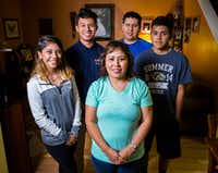 Breast cancer survivor Imelda Vaquera-Torres (center) stands with daughter Alexandra Vaquera (left), 20; son Isaace Vaquera, 18; husband Oscar Torres; and son Emmanuel Torres, 16. (Ashley Landis/Staff Photographer)