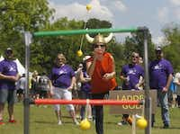 Trish Diep competes in ladder golf as Interstate Batteries team members compete during the Battery Bowl at Anderson Bonner Park in May 2015.(Michael Ainsworth/Staff Photographer)