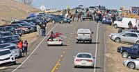 People protesting the Dakota Access Pipeline gathered along North Dakota Highway 1806 in Cannonball, N.D. (Tom Stromme/The Bismarck Tribune)