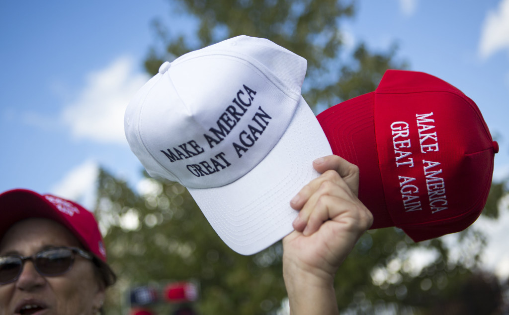 7458cce9903 Texas man arrested after wearing Trump hat