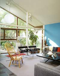 The pitched roof in the Prinz living room fills the space with light. In 2008,  the room is overflowing in architecturally significant furniture. (Stephen Karlisch/Special Contributor)