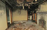 <p>Didaco Bianchi sculpted the mantel, which survived the fire three years ago and could still be seen in this June photo taken by city officials.</p>