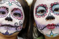 Sisters Cristal Ortega, 4 (left), and her sister Kenya Ortega, 7, show off their day of the dead face paint they received during the ArtLoveMagic Dia de los Muertos en Dallas event in 2014. (Ben Torres/ Special Contributor)