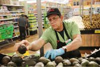 Produce alert Luis Pineda arranges the avocado stand in the produce department at Fiesta in Arlington, Texas Thursday October 27, 2016. (Andy Jacobsohn/ Staff Photographer)
