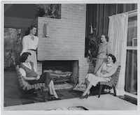 "<p><span style=""font-size: 1em; background-color: transparent;""></span></p><p>A 1950 'Dallas Morning News' file photo shows members of the Architects' Wives Club meeting in the Prinz living room. From left are Carol Decker (seated), Jeanette Prinz, club president <span style=""font-size: 1em; background-color: transparent;"">Mary Odessa Fife Mills</span><span style=""background-color: transparent; font-size: 1em;""> and Carol Kemp (seated, right). Trendy Jens Risom cotton-webbing and maple chairs from Knoll are pulled up for seating. (Clint Grant/The Dallas Morning News archives)</span></p><p></p>"