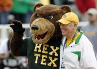 "<p><span style=""font-size: 1em; background-color: transparent;"">Ken Starr, then Baylor's president, with the school's mascot before a football game between the Bears and the University of Texas in Waco on Dec. 3, 2011.</span></p>(Vernon Bryant/Staff Phptographer)"