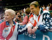 In this July 23, 2004, file photo, Martha and Bela Karolyi watch together as the U.S. women's gymnastic team celebrates winning the gold medal at the Centennial Summer Olympic Games in Atlanta. (AP Photo/Amy Sancetta, File)(AP)