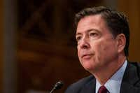 FBI Director James Comey testified to the bureau closing its investigation into Hillary Clinton's email practices, leading him to revise the record Friday with a new letter to Congress, after new messages were found on a laptop belonging to Anthony Weiner, estranged husband of Clinton aide Huma Abedin.(Zach Gibson/Bloomberg)
