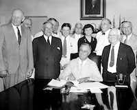 "In this Aug. 14, 1935, file photo President Franklin Roosevelt signs the Social Security bill in Washington. (<p><span style=""font-size: 1em; background-color: transparent;"">AP Photo, File</span></p>)"