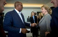 Former Dallas Mayor Ron Kirk talks with Annette Simmons at the announcement of a $50 million donation from Simmons for a park along the Trinity River.((G.J. McCarthy/Staff Photographer))