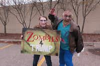 """Dorothy Kolman, 17, and her dad, Glenn Kolman, 45, of Fraser, Mich., offered playful support for Donald Trump at a Halloween rally at Macomb Community College on Oct. 31, 2016. """"We believe that Donald Trump needs the zombie vote because every vote counts,"""" Dorothy said.(Todd J. Gillman/Staff)"""