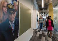 USAA workers walk down the hallway of the insurance company's office building in Plano. (Rex C. Curry/Special Contributor)