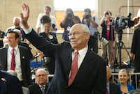 Former U.S. Secretary of State Colin Powell waved before arrival of President Barack Obama at Benjamin Banneker Academic High School in Washington, D.C., on October 17.   Republican ex-secretary of state Colin Powell announced Tuesday he will vote for Democrat Hillary Clinton in the November 8 presidential election.  (2016 File Photo/AFP/Getty Images)
