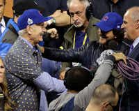 Bill Murray and Eddie Vetter celebrate after Game 7 of the Major League Baseball World Series between the Cleveland Indians and the Chicago Cubs Thursday.(AP)