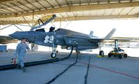 Maintenance crews prepared an F-35A for a training flight last month at Hill Air Force Base, Utah.((George Frey/Bloomberg))