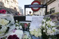 Floral tributes are placed at the scene where Italian Prince Filippo Corsini was killed on his bicycle outside Knightsbridge underground station in London.  (Tim Ireland/The Associated Press)